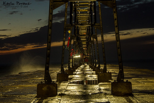 longexposure sunset sky usa lighthouse reflection wet water night clouds dark photography evening pier iron december unitedstates michigan ottawa cement lakemichigan late splash catwalk grandhaven 2014 westmichigan ottawacounty southwestmichigan kevinpovenz