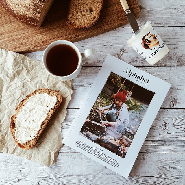 Taking a break from shooting food to eat - and finally relax w my new copy of the first @alphabetjournal ?? That pumpkin sourdough from @thorough_bakery w a thick schmear of @pepesaya creme fraiche (seriously best thing ever to put on bread) and a c