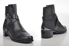 heel(0.0), outdoor shoe(0.0), brown(0.0), limb(0.0), leg(0.0), human body(0.0), footwear(1.0), shoe(1.0), leather(1.0), motorcycle boot(1.0), buckle(1.0), boot(1.0),