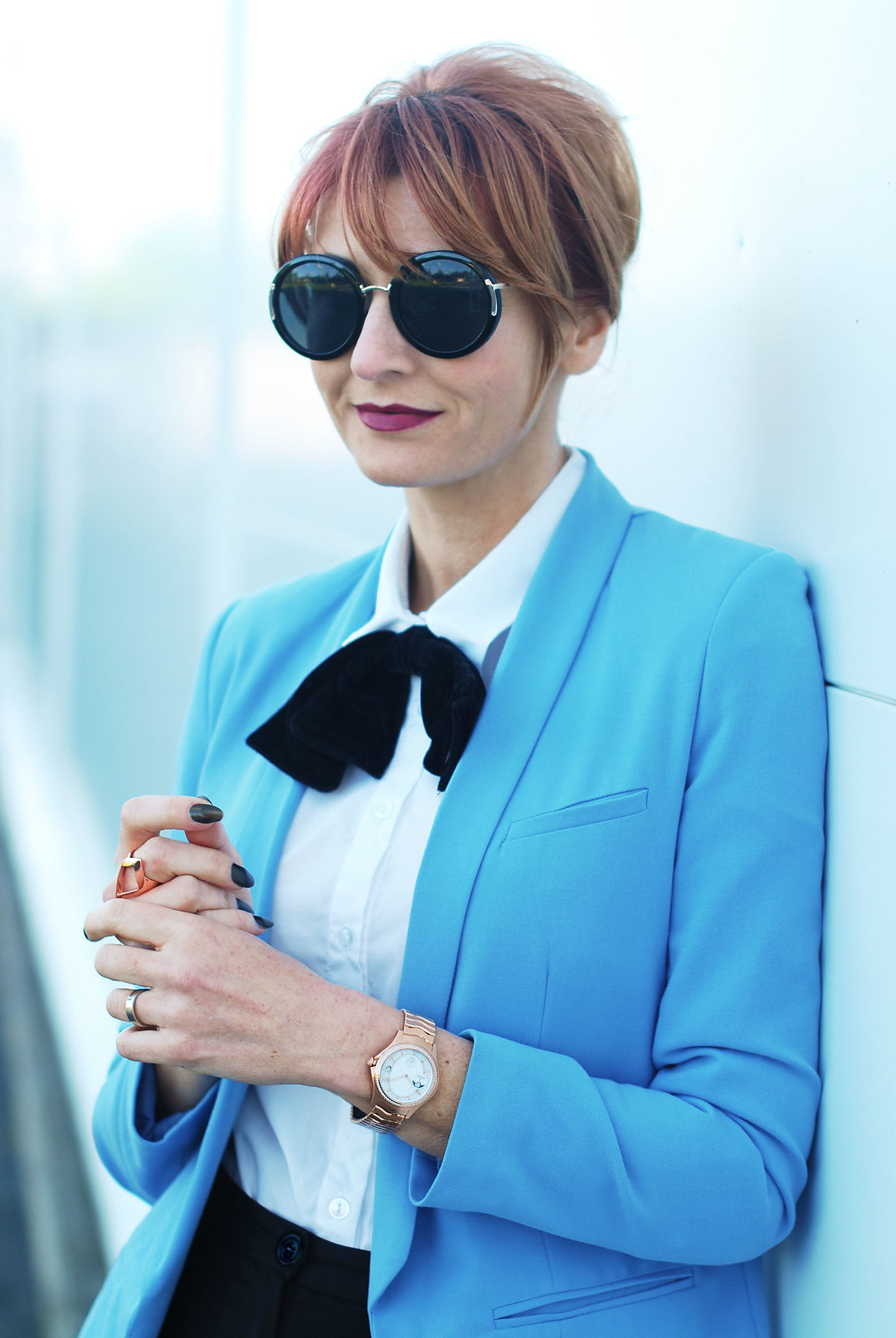 Maison EBEL collection rose gold diamond watch, sky blue blazer, black velvet bow tie, oversized round sunglasses | Not Dressed As Lamb