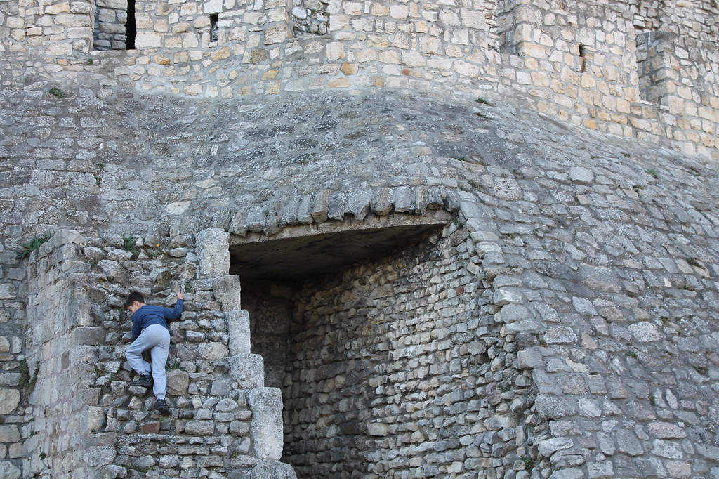 kid climbing fortress