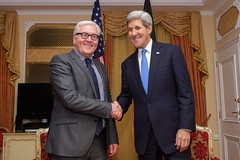 U.S. Secretary of State John Kerry shakes hands with German Foreign Minister Frank-Walter Steinmeier in Vienna, Austria, on November 22, 2014, before a bilateral meeting about the status of the nuclear program negotiations between the P5+1 nations and Iranian officials. [State Department photo/ Public Domain]