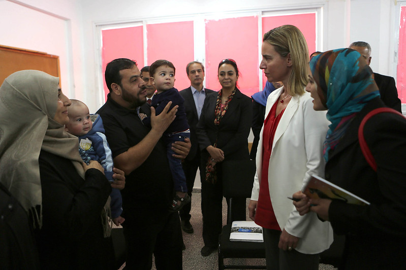 Federica Mogherini (2nd R), High Representative of the Union for Foreign Affairs and Security Policy and Vice-President of the EC meets a palestinian family (L) during a visit of the UN-run Baharin Kingdom boys school where sheltering Palestinians, whose houses were destroyed during the most recent conflict between Israel and Hamas on November 8, 2014 in Gaza City.