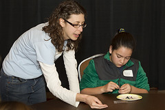 Lab scientist Mindy Zimmer and a student from Cuba Elementary School examine crystals during the 2014 Expanding Your Horizons conference's Minerals and Makeup Workshop in Santa Fe.
