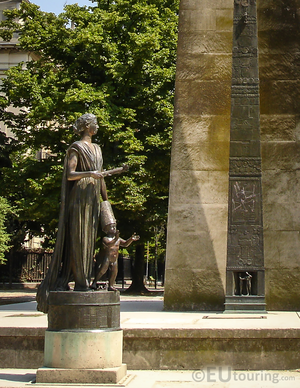 Bronze statue of a woman and child