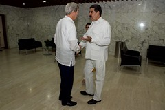 U.S. Secretary of State John Kerry shakes hands with Venezuelan President Nicolás Maduro inside the Cartagena Indias Convention Center in Cartagena, Colombia, on September 26, 2016, as they prepare to hold a bilateral meeting after they both attended a peace ceremony between the Colombian government and the Revolutionary Armed Forces of Colombia (FARC) that ended a five-decade conflict. [State Department Photo/Public Domain]