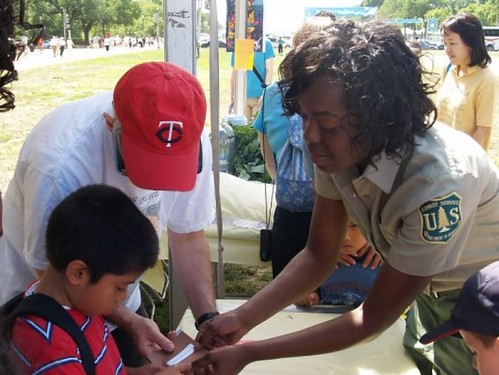 Michaela Hall, a workforce program specialist for the U.S. Forest Service, leads an educational activity to explain how important the sun is to plant life during a National Get Outdoors Day Event held in Washington, D.C.  (U.S. Forest Service photo/Victor Fowler)