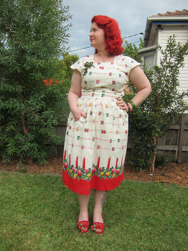 novelty print christmas border print fabric 1940s dress