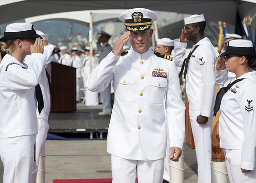 PEARL HARBOR - Cmdr. Matthew H. Hall, commanding officer of the guided-missile destroyer USS John Paul Jones (DDG 53), passes through sideboys during a change of command ceremony at Joint Base Pearl Harbor-Hickam.