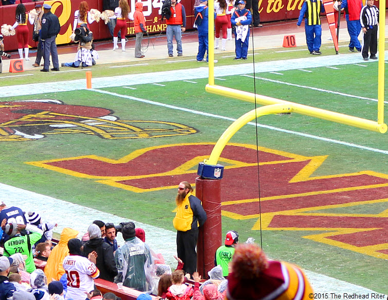 25 man stands at goalpost during dallas cowboys vs washington redskins game