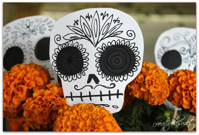 Marigolds and day of the dead skull planter sticks