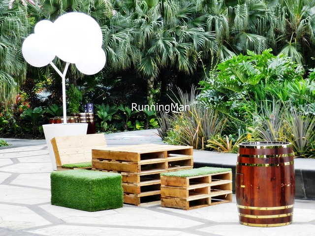 Christmas Wonderland 2014 - Grass Lawn Chairs And Barrel Tables