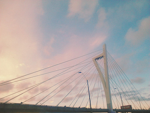 road city bridge pink sunset sky urban panorama colour architecture clouds skyscraper sunrise puente uruguay photography skies afternoon view cloudy outdoor monumento perspective sunsets lookingup lightleaks perspectiva montevideo sunrises overlooking carrasco lateafternoon vsco uruguaynatural allsunsets vscofilm vscocam