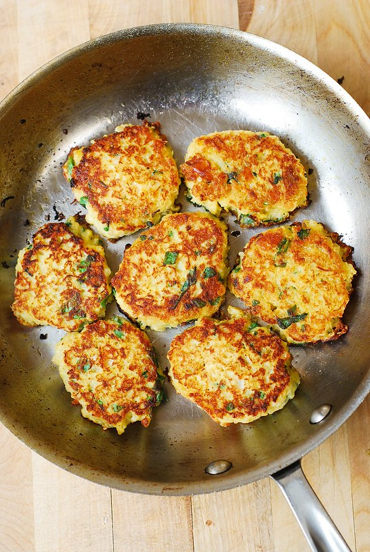 cooking fritters in a frying pan, quinoa fritters, delicious fritters