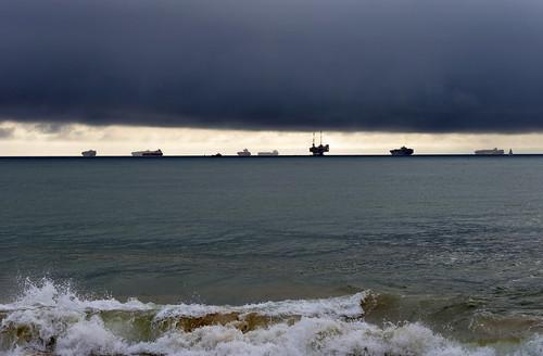 ocean sea sky storm water silhouette sunrise coast harbor seaside sand waves pacific outdoor ships horizon shoreline longbeach shipping sealbeach oilrigs