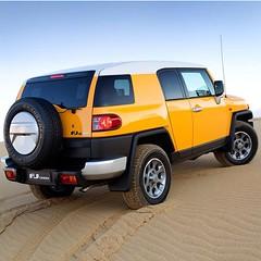 jeep wrangler(0.0), automobile(1.0), automotive exterior(1.0), sport utility vehicle(1.0), wheel(1.0), vehicle(1.0), toyota fj cruiser(1.0), compact sport utility vehicle(1.0), off-roading(1.0), off-road vehicle(1.0), bumper(1.0), land vehicle(1.0),