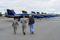 U.S. Secretary of State John Kerry walks toward F/A-18 fighter jets used by the Blue Angels, the U.S. Navy's flight demonstration team, as he stopped at Joint Base Elmendorf-Richardson on July 27, 2016, for an aircraft re-fueling while the team was in town to perform at the upcoming Arctic Thunder air show. [State Department Photo/ Public Domain]