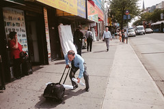 Man falling down in Flushing Queens, New York City
