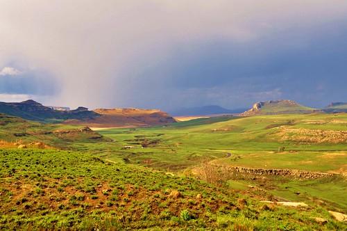 road cloud sun rain rural landscape southafrica rainstorm downpour freestate windingroad d90 harrismith termitehills stevelamb