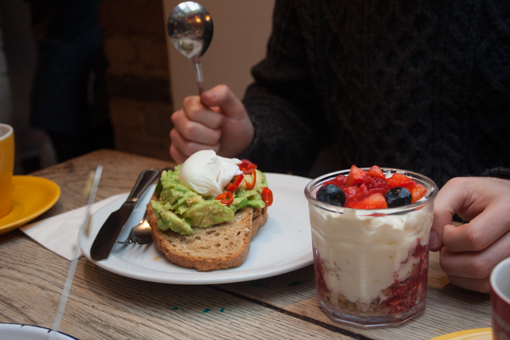 Avocado and poached egg toast; fruit and yoghurt glass, The Breakfast Club