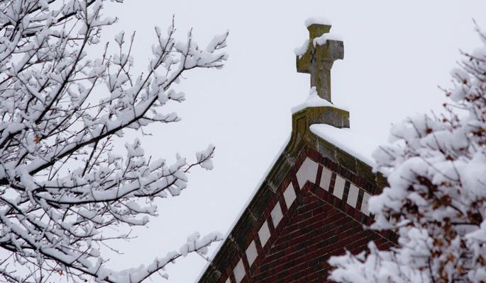 Newman-University-snow-cross-Sacred-Heart