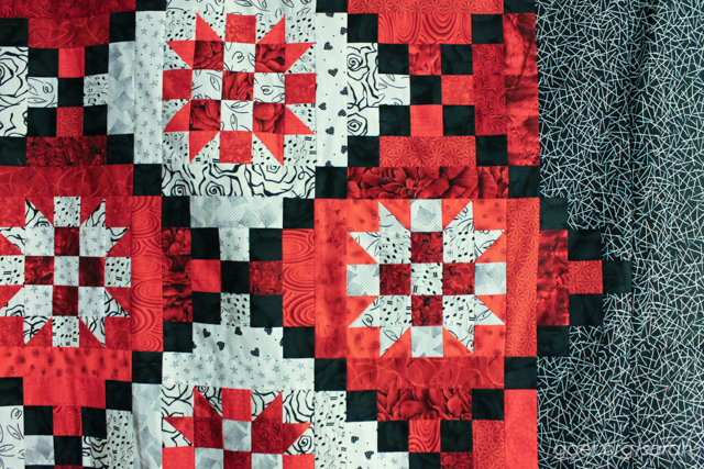 detail view of red, black and white mystery quilt