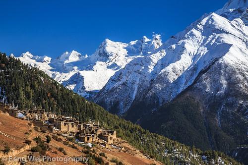 travel nepal color tourism vertical landscape asia village outdoor scenic tibetan remote annapurnacircuit annapurna himalayas prayerflag gyaru gandaki annapurnaii ghyaru annapurnaconservationarea