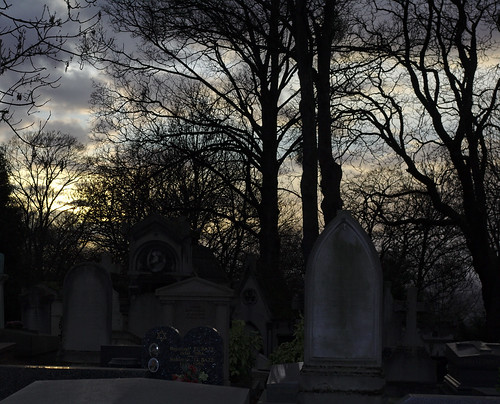 on Père Lachaise Cemetery at sunset