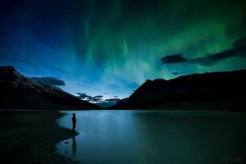 """Opening Act"" Another image from Saturday night's aurora display over the Canadian Rockies. It wasn't even dark yet that green curtains were already dancing all over the sky. The lights then went on showing off until daybreak. Self-portrait, Sunwapta Lake"