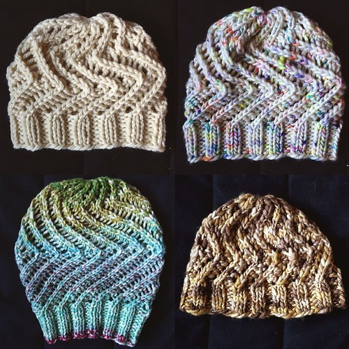 Here are the 4 insta-hats I made.  Clockwise from top left: main sample, size small, before blocking; size medium sample, also before blocking; size large stitch count, small-ish height, after blocking and wearing a bunch; size large stitch count, extra l
