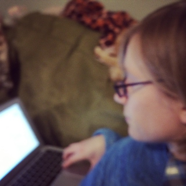 More feedbacking, this time on the couch. (Out-of-focus is appropriate; I'm having the hardest time focusing thanks to the sleep deprivation regimen M is inflicting on us).