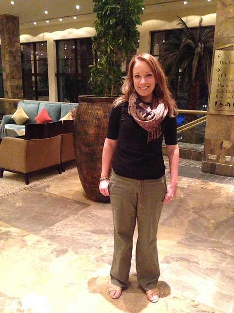 Rachelle in Jordan wearing linen pants, sandals, and a 3/4 sleeve shirt.