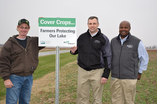 From left to right, Hardin County farmer Jerry McBride, AgCredit CEO Brian Ricker and Ohio State Conservationist Terry Cosby place the first cover crop sign in McBride's cover crop field which contains a mix of oilseed radish, hairy vetch, and cereal rye. NRCS photo by Dianne Johnson.