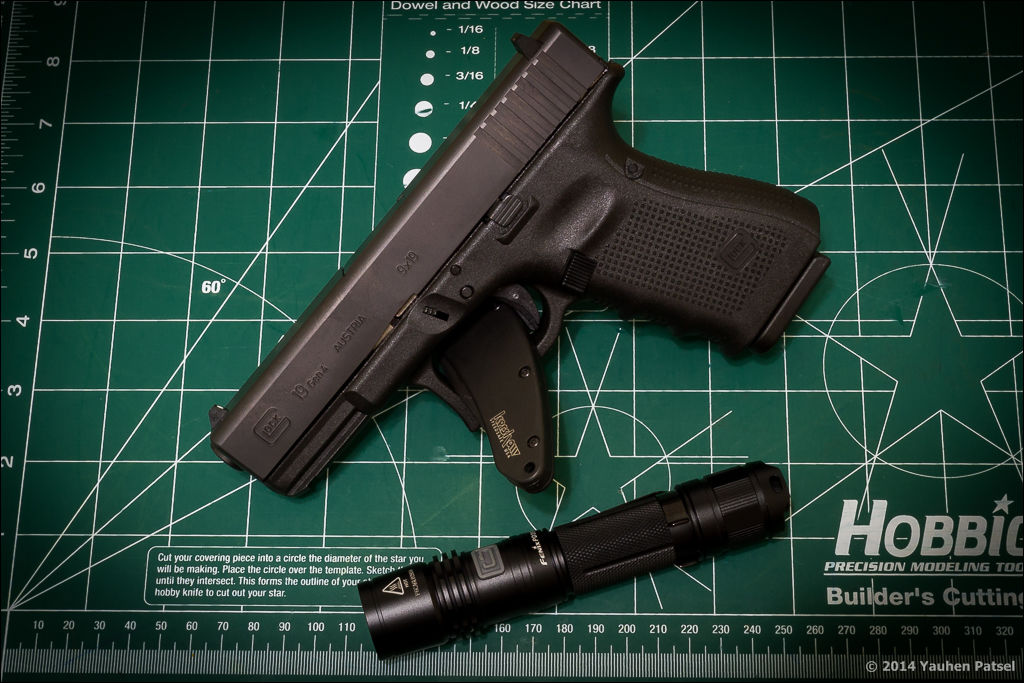Handgun, knife, and flashlight