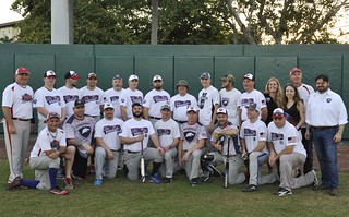 The Tampa Bay VETSports team poses for a group picture at the 2nd Annual St Petersburg, Fla., Softball Series at Al Lang Stadium on Saturday, Dec. 6, 2014. VETSports team members are disabled active and reserve veterans that participate in sports, physical activity and community involvement in an effort to ease the transition back to a civilian lifestyle. (U.S. Coast Guard photo by Seaman Meredith A. Manning)