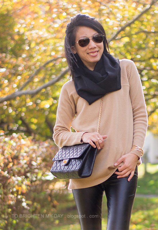 black scarf, camel sweater, black leather pants, gold jewelry