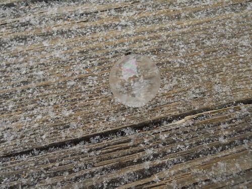 frozen soap bubble and snowflakes