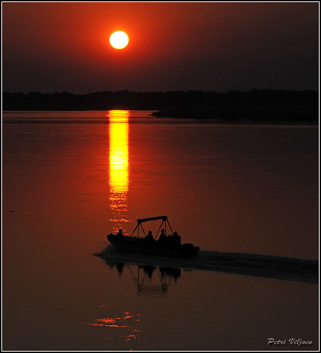 africa reflection water sunrise boat fishing zambia zambeziriver lowerzambezi nikond300