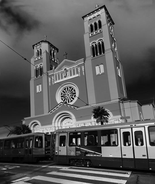 N Judah train passing St. Anne of the Sunset Catholic Church; Judah and Funston St; Inner Sunset, San Francisco (2014)