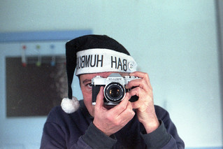 reflected self-portrait with Canon Pellix camera and festive hat