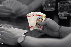 monochrome photography(0.0), monochrome(0.0), black-and-white(0.0), hand(1.0), poker(1.0), games(1.0), gambling(1.0), black(1.0),