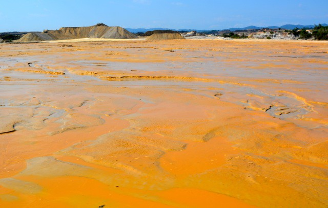 river turned yellow from gold mining pollution