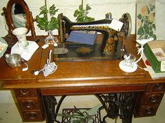 antique(0.0), sewing machine(1.0), art(1.0), furniture(1.0), room(1.0), table(1.0), iron(1.0),