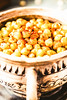 baked chickpeas with spices on rustic background, close-up