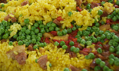 Chicken, Sausage, Saffron Paella with Peas and som…