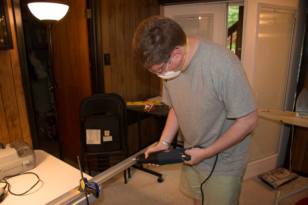 Using reciprocating saw to cut top track of Ikea Pax