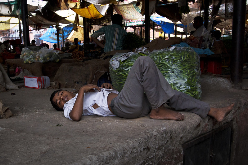 boy relaxing at market