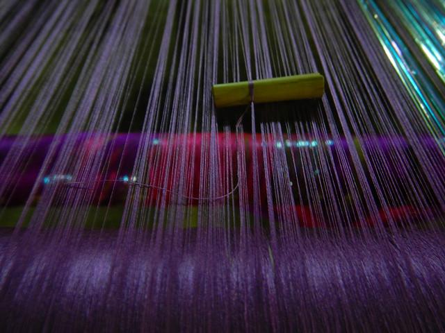 Purple threads at a weavering workshop in Mandalay, Myanmar