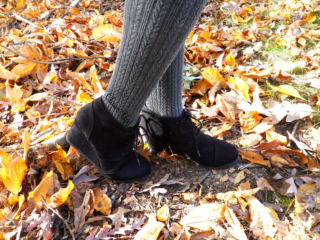 Gray cable knit tights and black wadge booties