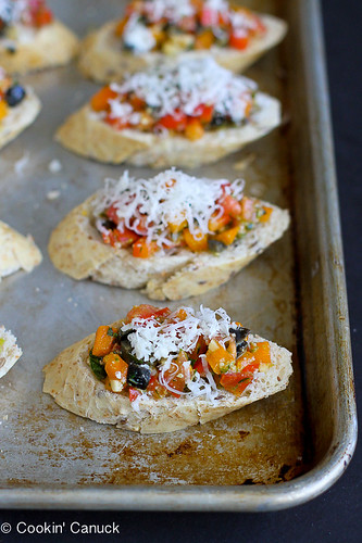Skinny Pesto Pizza Crostini...Great for a crowd!  So easy that the kids can make these. 51 calories & 1 Weight Watcher PP | cookincanuck.com #recipe #appetizer #vegetarian